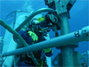 NEEMO aquanaut operating crane underwater