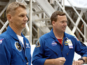STS-120 mission specialists Piers Sellers, left, and Mike Foreman, right, in training at the Space Station Processing Facility. Foreman was a Cape Crusader on several Shuttle missions before he was named to the STS-120 crew.