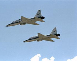 Astronauts travel between NASA-JSC and NASA-KSC in T-38 jets. The jets can make the trip in about an hour and a half.