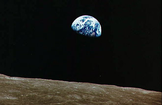The Earth rises above the lunar surface during Apollo 8.