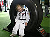 Girl sits in space shuttle tire