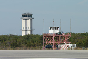 This control tower (foreground), built in 1987, was too low and too close to the runway. The new tower is visible in the distance.