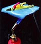 Crayons lay unmelting on top of a piece of aerogel as a blowtorch is applied underneath
