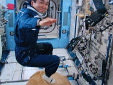 Astronaut Koichi Wakata conducts the Magic Carpet activity as part of the Try Zero G experiment.