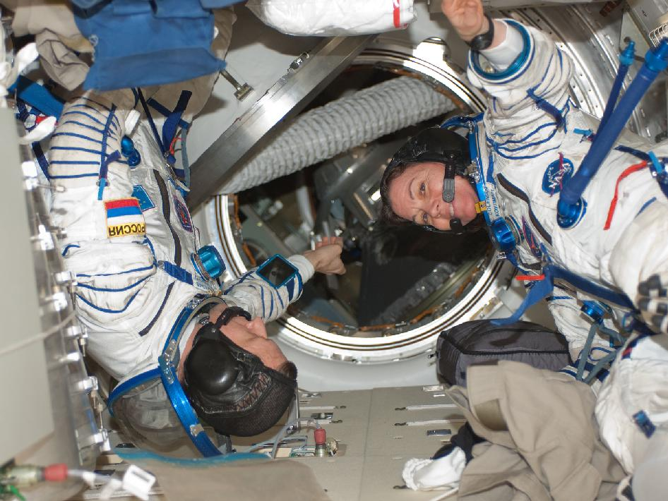 Expedition 27 Commander Dmitry Kondratyev and Flight Engineer Cady Coleman