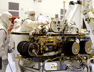 The plaque is visible as technicians at Kennedy Space Center prepare Spirit for launch.