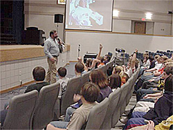 Picture of Tom Nolan speaking to kids about science