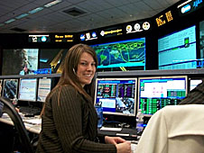 Ashley Allman sitting at a computer console in Mission Control