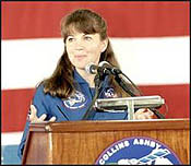 Astronaut Catherine G. (Cady) Coleman, mission specialist, speaks to the large crowd that turned out at Ellington Field to welcome home the STS-93 astronauts on April 28, 1999.