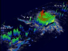 TRMM 3-D image showing thunderstorm towers punching heights of over 16 km (~9.9 miles) above the ocean's surface.