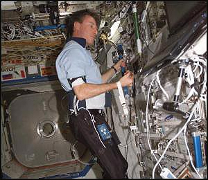 Astronaut wearing Lower Extremity Monitoring Suit (LEMS)