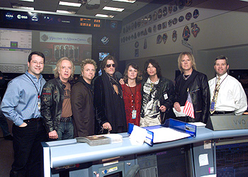 The Aerosmith band members with members of the flight control team in Mission Control at Johnson Space Center in Houston, Texas.