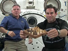 Greg Johnson and Greg Chamitoff play chess