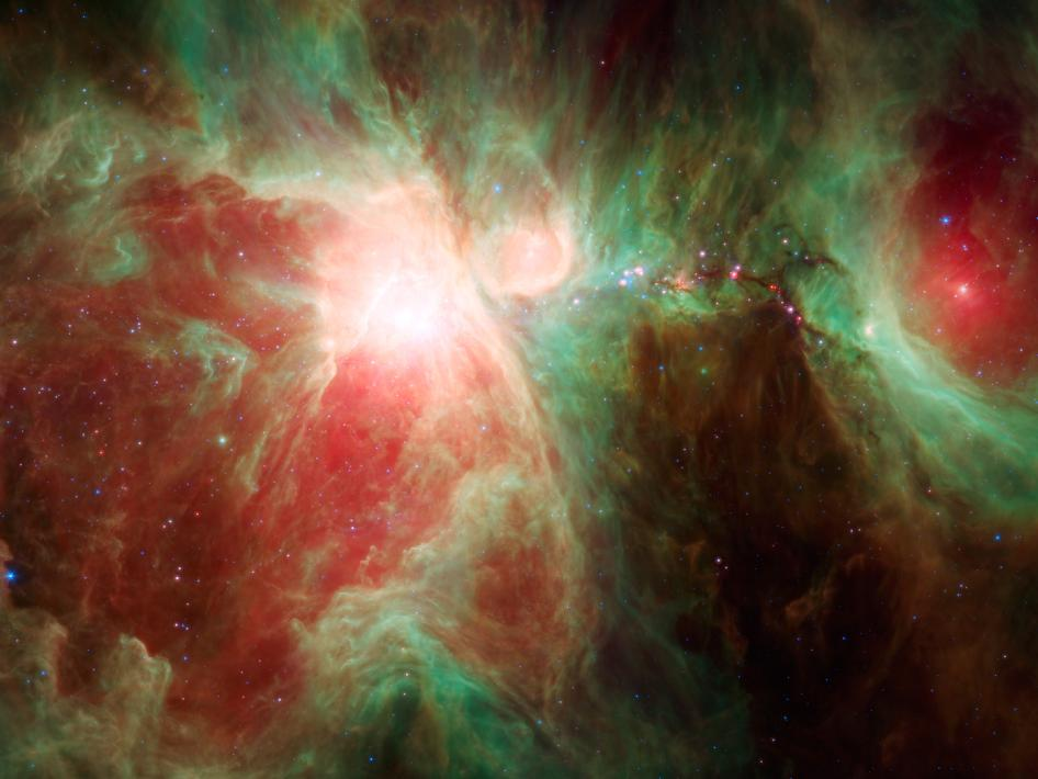 This image from NASA's Spitzer Space Telescope shows what lies near the sword of the constellation Orion -- an active stellar nursery containing thousands of young stars and developing protostars