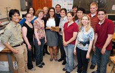MIT students pose with a model of their planet-finding CubeSat.