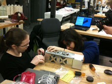 Students work on the planet-finding CubeSat.