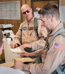 NASA research pilot Nils Larson and flight engineer Mike Holtz discuss last-minute preparations before a SCAMP flight.