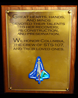 This closeup image shows the words of the plaque displayed in the Columbia room of the Vehicle Assembly Building at KSC.