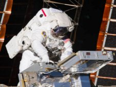 NASA astronaut Andrew Feustel retrieves long duration materials exposure experiments before installing others.