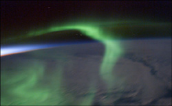 The ISS-6 crew enjoyed this green aurora dancing over the night side of the Earth just after sunset.
