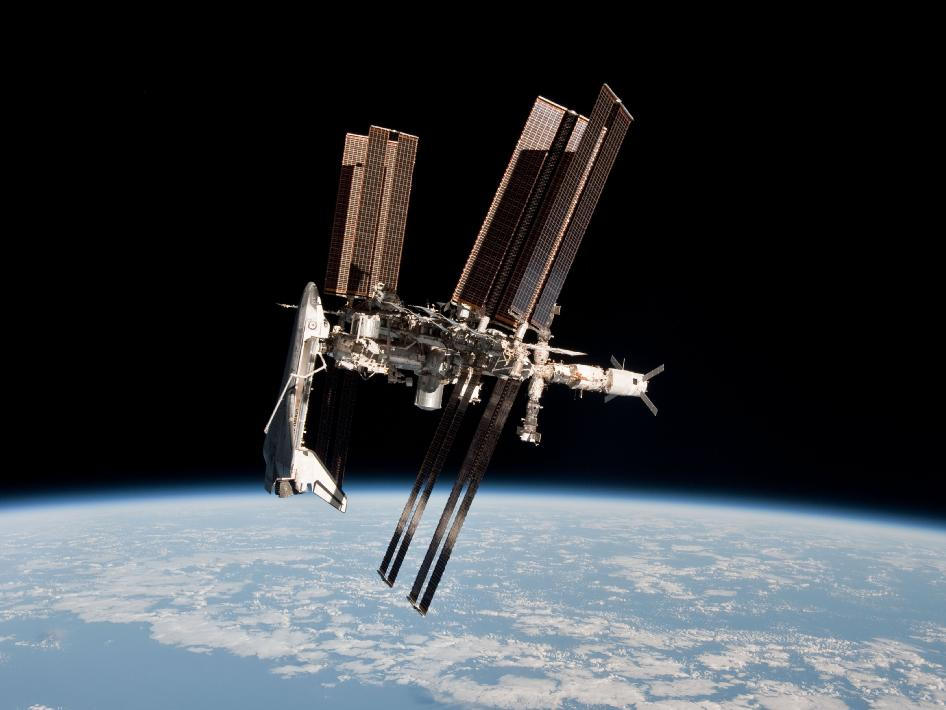 shuttle and station docked in orbit