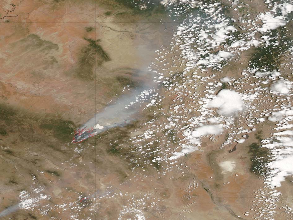 Plumes of smoke cover parts of eastern Arizona, as the Wallow North fire continues to grow