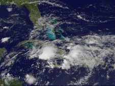 GOES image showing the large, elongated area of low pressure over eastern Cuba, Jamaica and Hispaniola.