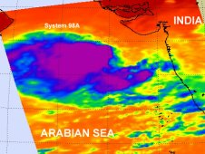AIRS captured System 98A's cloud temperatures and thunderstorms on June 8and saw a large area of strong convection (purple).