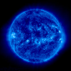 A blue image of the Sun taken by NASA's SOHO satellite.