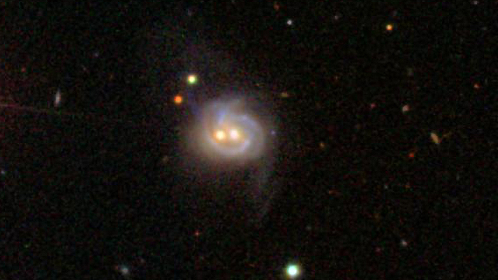Nearby Galaxy Boasts Two Monster Black Holes, Both Active