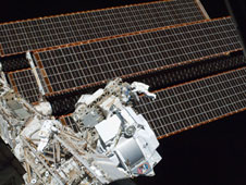 Mission Specialists Andrew Feustel and Greg Chamitoff spacewalking