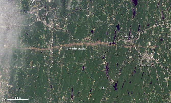 This is a Landsat 5 satellite image of the area between Springfield and Sturbridge, Mass. taken on June 5, 2011 that clearly shows the light-colored tornado track.