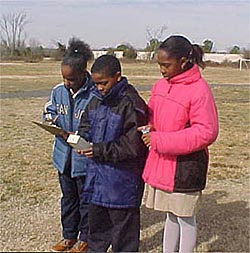 picture of Dymond Grayson, Tevon McClary and ShaTira Waller collecting aerosol data