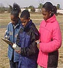 Dymond Grayson, Tevon McClary and ShaTira Waller collecting aerosol data