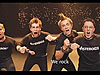 Four teens imitating punk rockers wear t-shirts that say asteroids