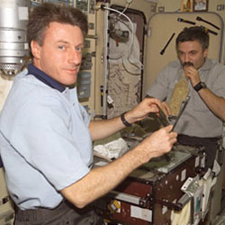 Expedition 8 crew members Mike Foale and Alexander Kaleri are good at maintaining the ISS stowage database.