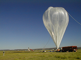 A NASA research balloon is inflated and prepared for launch.