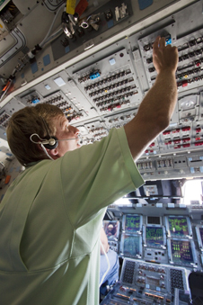 A technician works inside shuttle Atlantis following its landing on the STS-132 mission