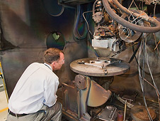 NASA Chief Technologist Bobby Braun inspects the Electron Beam Freeform Fabrication system