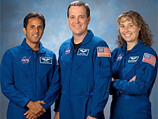 Two men and a woman in blue flight suits
