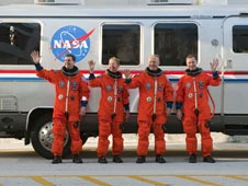 STS-135 Mission Specialists Rex Walheim and Sandy Magnus, Pilot Doug Hurley and Commander Chris Ferguson next to the Astrovan.