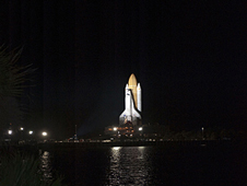 Space shuttle Atlantis on the launch pad at night