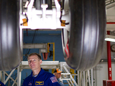 Commander Chris Ferguson inspects Atlantis' landing gear