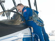 Pilot Doug Hurley looks into a T-38 aircraft