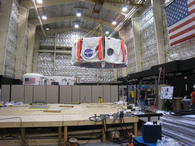 The X-Hab loft built by the University of Wisconsin-Madison team is lifted and moved to the Habitat Demonstration Unit (HDU).
