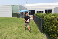 A student prepares to release a weather balloon at Kennedy