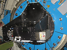 The High-Speed Imaging Photometer for Occultations, or HIPO, instrument is attached to the interior portion of the infrared telescope.