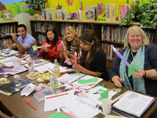 Teachers work on a rocket activity
