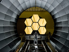 NASA engineer looks on as the first six flight ready James Webb Space Telescope's primary mirror segments are prepped.