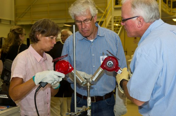 Petra Neuhause, Harold Lenski and Jeff Clancy use a heat gun to open the first U.S. sample cartridge